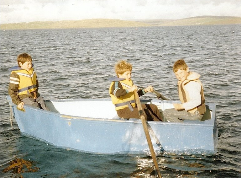 Bjorn Sandison as a child, at sea in a row boat with friends